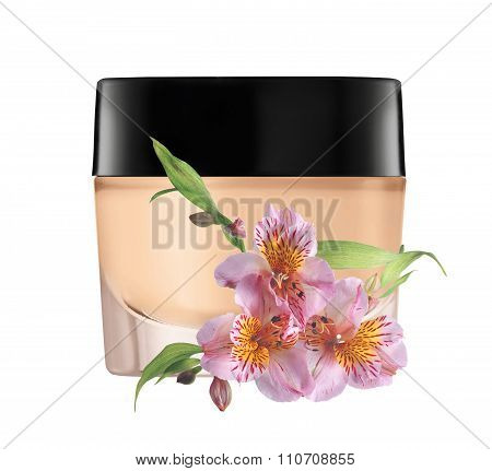 Glass Jar Of Face Cream And Lilly Flower Isolated On White