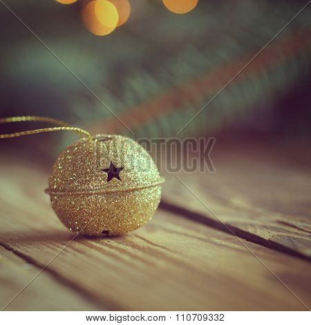 Metal Jingle Bell With Star On Wooden Table. Toned Image Picture