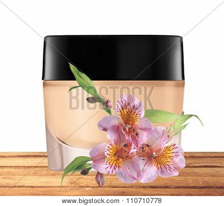 Glass Jar Of Face Cream And Lilly Flower On Wooden Table Isolated On White