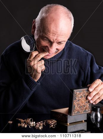 Senior Jeweler With  Magnifying Glass