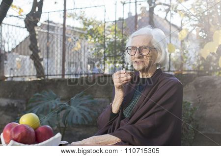 Old Grandma Having Cup Of Coffee Outdoors
