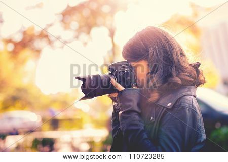 Attractive Young Woman Photographer Taking Pictures With Professional Digital Camera Outside
