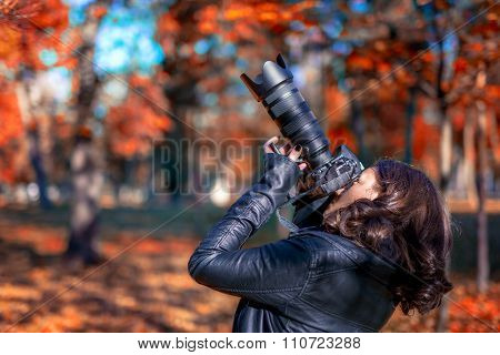 Brunette Young Woman Photographer Taking Pictures On An Autumn D