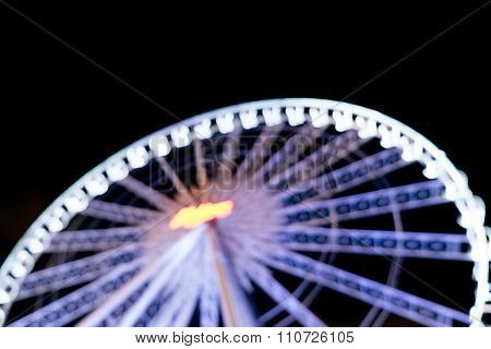 Blurred Defocussed Abstract Background Of A Ferris Wheel At Night