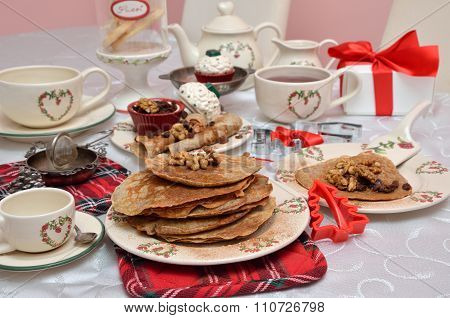 Bunch Of Delicious Pancakes On Christmas Crockery