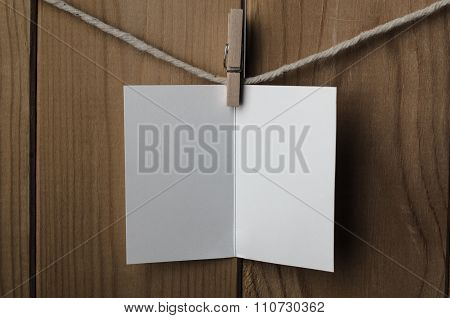 Blank White Opened Greetings Card Pegged To String