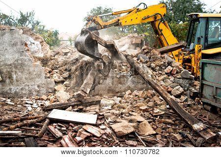 Industrial Excavator And Bulldozer Loading Debris And Demolition concrete walls