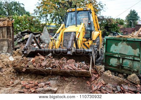 Industrial Excavator And Bulldozer Loading Debris And Demolition