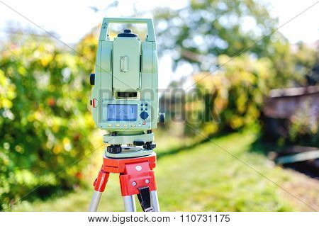 Surveying Equipment With Transit Total Station And Theodolite With garden background