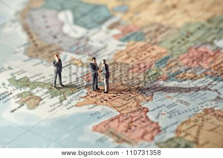 Miniature Business People On Map Of Europe. Color Tone Tuned
