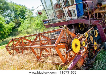Combine Corn And Wheat Harvester. Agriculture Industry On Rural crops