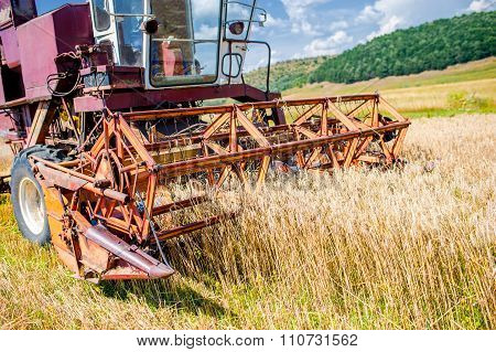 Close-up Of Wheat Harvesting Machinery. Agricultural Activities