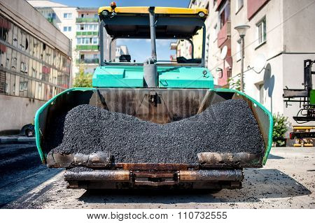 Industrial Paver Laying Fresh Asphalt And Bitumen Pavement On Top of gravel layer