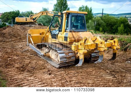 Industrial Backhoe Truck Moving Earth And Soil In Quarry Construction site