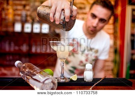 Barman Pouring A Margarita Alcoholic Cocktail Served In Casino And Bar