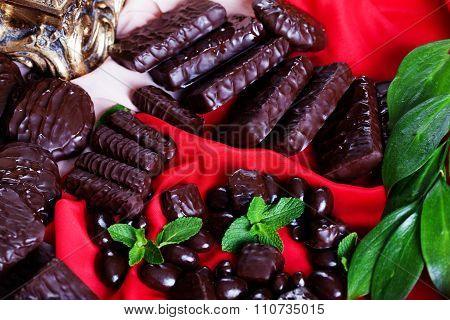 chocolates and jelly beans in bulk on a red silk fabric beautiful