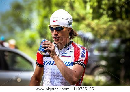 young cyclist drinking carbonated water before start of Cycling