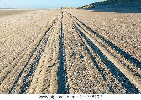 Tracks In The Sand Of The Beach