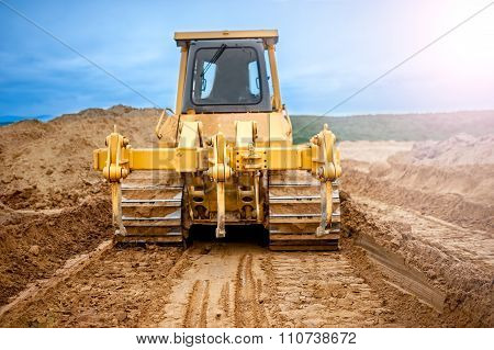 Bulldozer With Steel Blade Moving Soil And Sand Around And Working