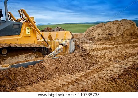 Heavy Bulldozer And Excavator Loading  And Moving Red Sand Or Soil on road