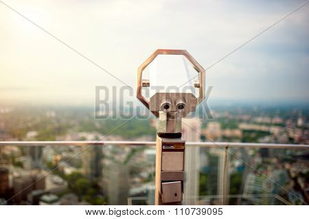 Hand Held Telescope On Top Of Skyscraper At Observation Deck To admire city skyline