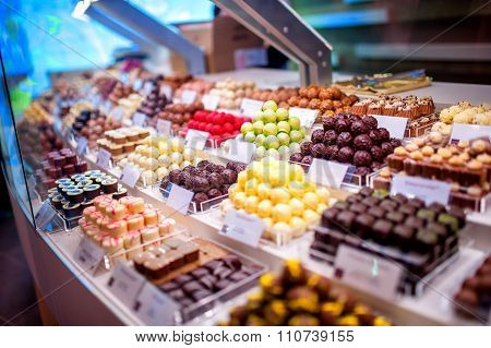 Chocolate Truffes, Candies And Sweets Store On Showcase In Factory