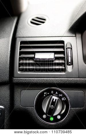 Car Ventilation System And Headlight Adjustment On Dashboard Of modern car