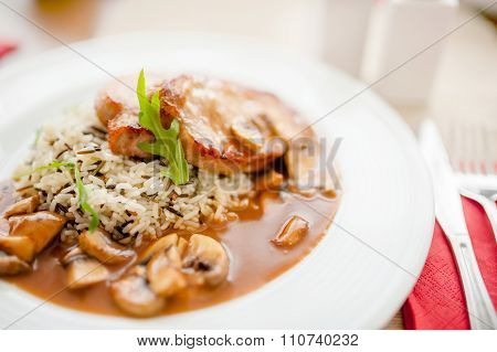 Juicy,  Suculent Grilled Pork Chops With Mushrooms And Rice As Main course