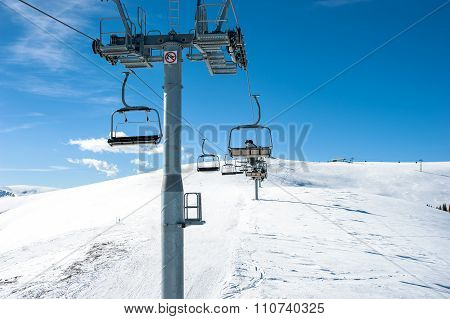Chairlift On Ski Slope In Mountain Resort
