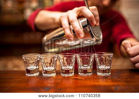 Close-up Of Bartender Hand Pouring Alcoholic Drink In Nightclub