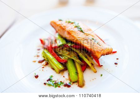 Smoked Salmon With Fried Vegetables As Main Dish At Local Restaurant