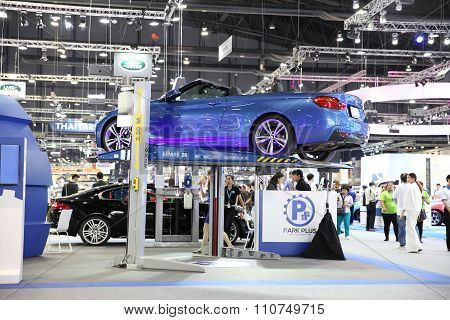 Bangkok - December 1: Mechanics Garage With Car On Hoist At The Motor Expo 2015 On December 1, 2015