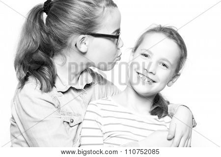 Two sisters  in front of white background
