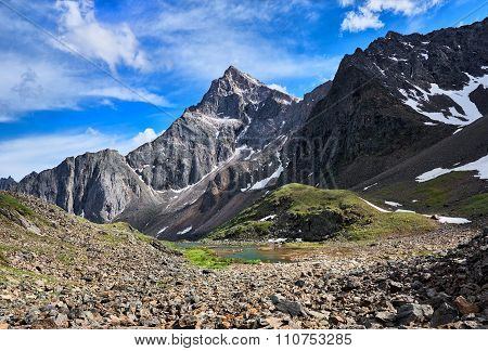 Pointed Peak In The Mountains Of Siberia