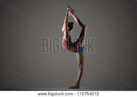 Gymnast Girl Doing Standing Backbend With Mace