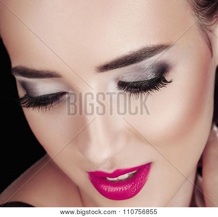 Beauty Woman With Perfect Makeup. Red Pink Lips And Nails. Face Isolated On Black