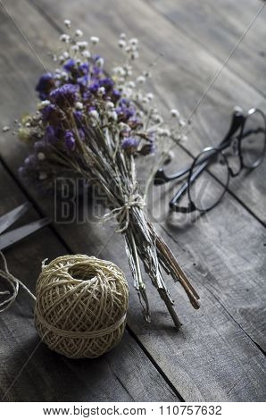 Dried Flowers On An Old Table