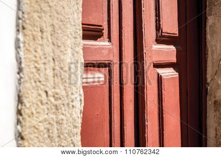 Antique red door on the city of Ouro Preto, Minas Gerais, Brazil
