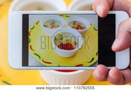 Photo of Fruit strawberry and kiwi jelly dessert thru smartphone