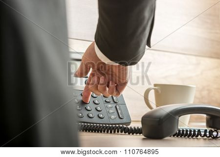 Businessman Dialing Telephone Number On A Classical Black Landline Telephone