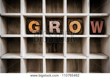 Grow Concept Wooden Letterpress Type In Draw