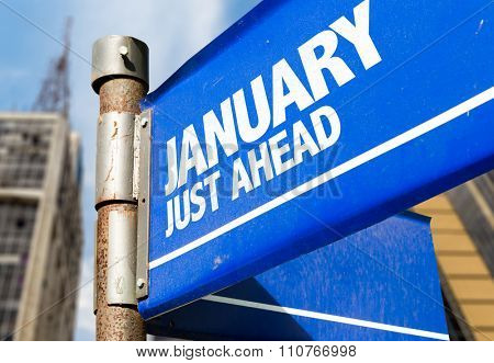 January road sign with urban background