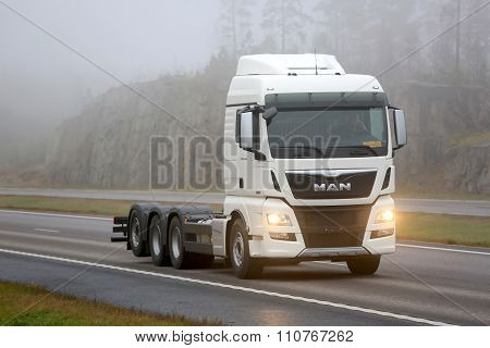 White MAN TGX 35.360 D38 Truck On Motorway