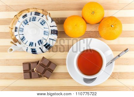 Cup Of Tea, Tangerines, Teapot And Chocolate Pieces