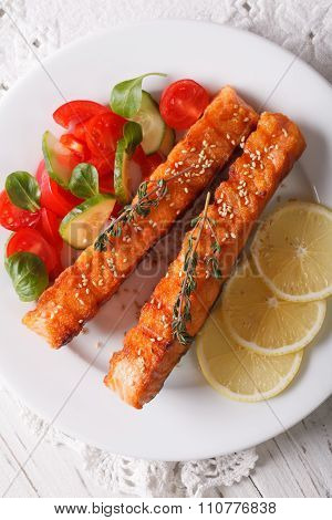 Grilled Salmon With Sesame And Fresh Salad Closeup. Vertical Top View