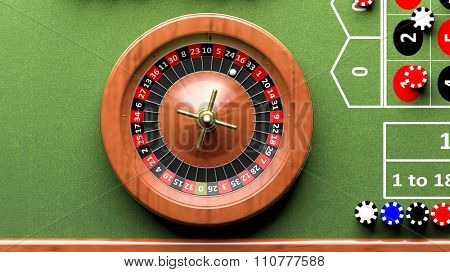 Roulette wheel on green table, poker chips.From above