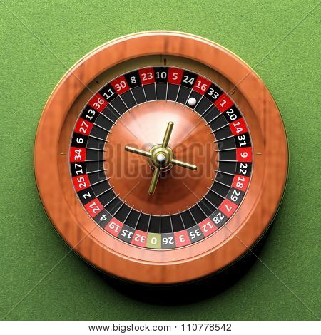 Close-up of roulette wheel on green background.From above