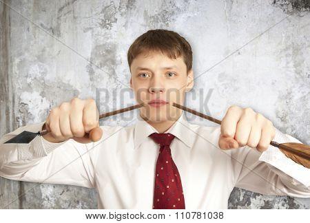 Businessman breaks down arrow. Peace concept