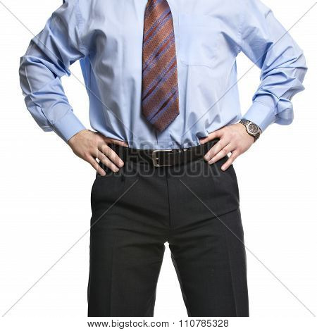 Businessman In Blue Shirt Stands With Hands On The Waist