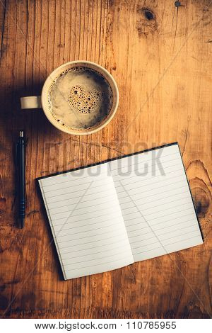 Open Notebook, Pencil And Cup Of Coffee